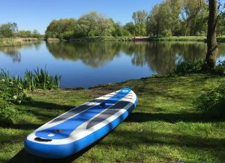 iRocker 10'6 Cruiser inflatable paddleboard at a lake